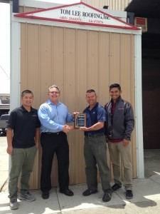 IP representative, Robert Cardenas, recognized Tom Lee Roofing for outstanding performance in sales and installation in 2014.